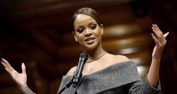 Singer Rihanna addresses an audience after being presented with the 2017 Harvard University Humanitarian of the Year Award during ceremonies, Tuesday, Feb. 28, 2017, at the Sanders Theatre on the school's campus, in Cambridge, Mass. (AP Photo/Steven Senne)