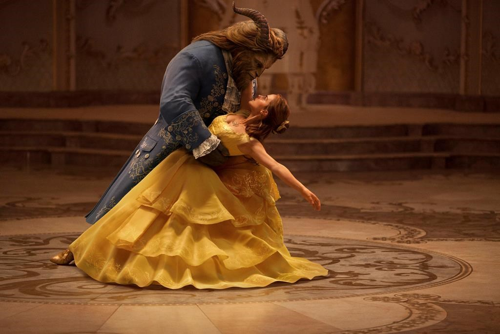 "This image released by Disney shows Emma Watson as Belle and Dan Stevens as the Beast in ""Beauty and the Beast,"" a live-action adaptation of the studio's animated classic. The film will be in theaters on March 17. (Disney via AP)"